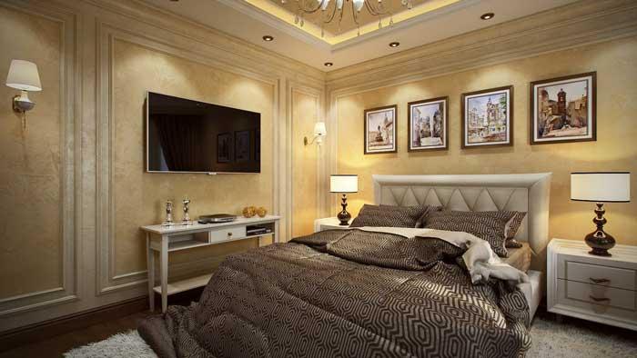 Дизайн спальни в классическом стиле с большим плазменным телевизором на стене